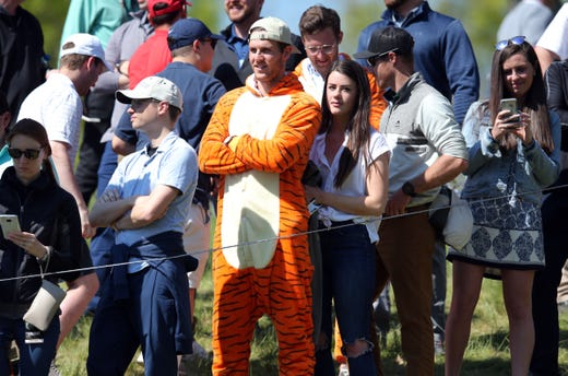 First round: A Tiger Woods fan looks on during Day 1.