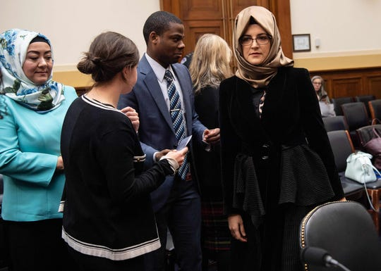 """Hatice Cengiz (R), the fiancee of slain Saudi journalist Jamal Khashoggi, arrives to testify before a House Foreign Relations subcommittee hearing on """"The dangers of reporting on human rights"""" on Capitol Hill in Washington, DC, on May 16, 2019. (Photo by NICHOLAS KAMM / AFP)"""