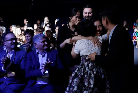 Members of Kitkit School embrace after winning the XPRIZE for Children's Literacy, Wednesday, May 15, 2019, in Los Angeles.