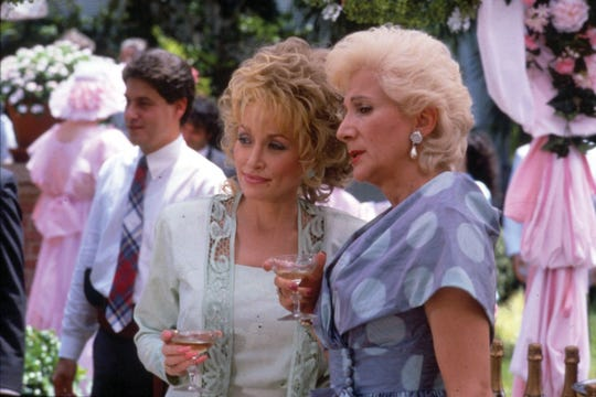 "Dolly Parton and Olympia Dukakis dish at the wedding reception in ""Steel Magnolias."""