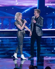 "Real-life couple Maddie Poppe, left, and Caleb Lee Hutchinson returned to ""Idol"" this season for a Disney-themed performance."