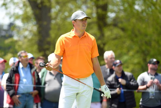 First round: Jordan Spieth watches his tee shot on the second hole.