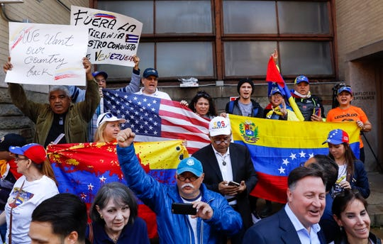 Supporters of Venezuela opposition leader Juan Guaido react after pro-Nicolas Maduro protesters were removed from inside Venezuela Embassy by US federal authorities in the Georgetown neighborhood of Washington, DC, USA, 16 May 2019.  EPA-EFE/ERIK S. LESSER ORG