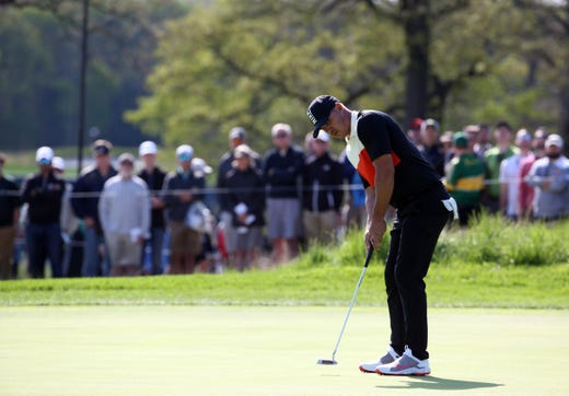 First round: Brooks Koepka, putting on the 12th hole, shot a course-record 63.