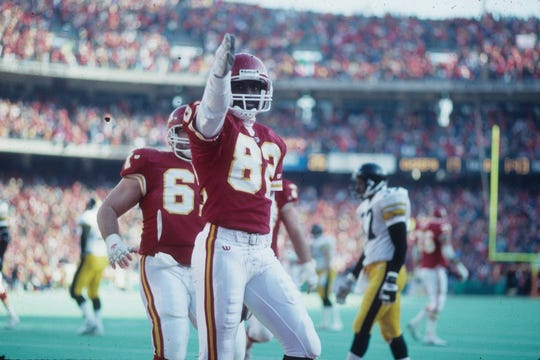 Former Chiefs wide receiver Tim Barnett celebrates scoring a touchdown in a 1993 playoff game.