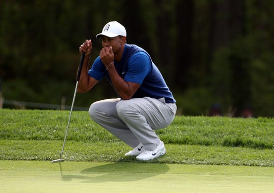 Tiger Woods lines up his putt on the 10th green.