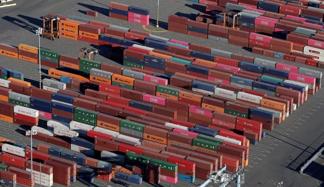 Cargo containers are staged near cranes at the Port of Tacoma, in Tacoma, Washington, in this March 5, 2019, file photo.