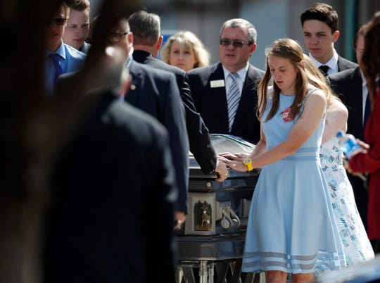 Pallbearers guide the casket to a waiting hearse on May 15, 2019, after a memorial service for Kendrick Castillo. The teen was killed in the May 7 assault on the STEM Highlands Ranch School in Highlands Ranch, Colorado.