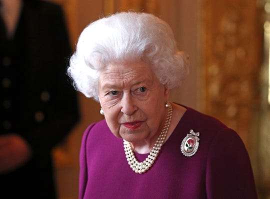 Queen Elizabeth II arrives to join members of the Order of Merit ahead of a luncheon at Windsor Castle on May 7, 2019.