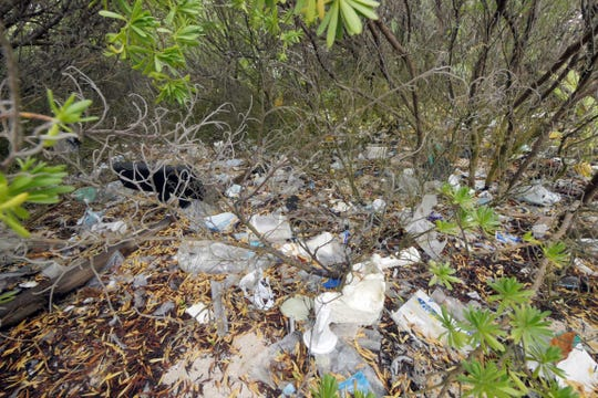 Trash is seen behind the beach on the northeast side of Home Island, one of the Cocos Islands.