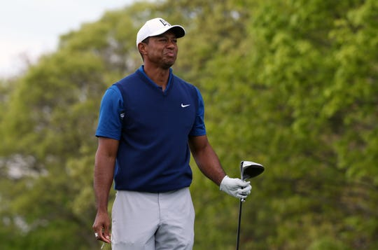 8b64e4f2 Tiger Woods reacts after his shot from the 10th tee during the first round  of the