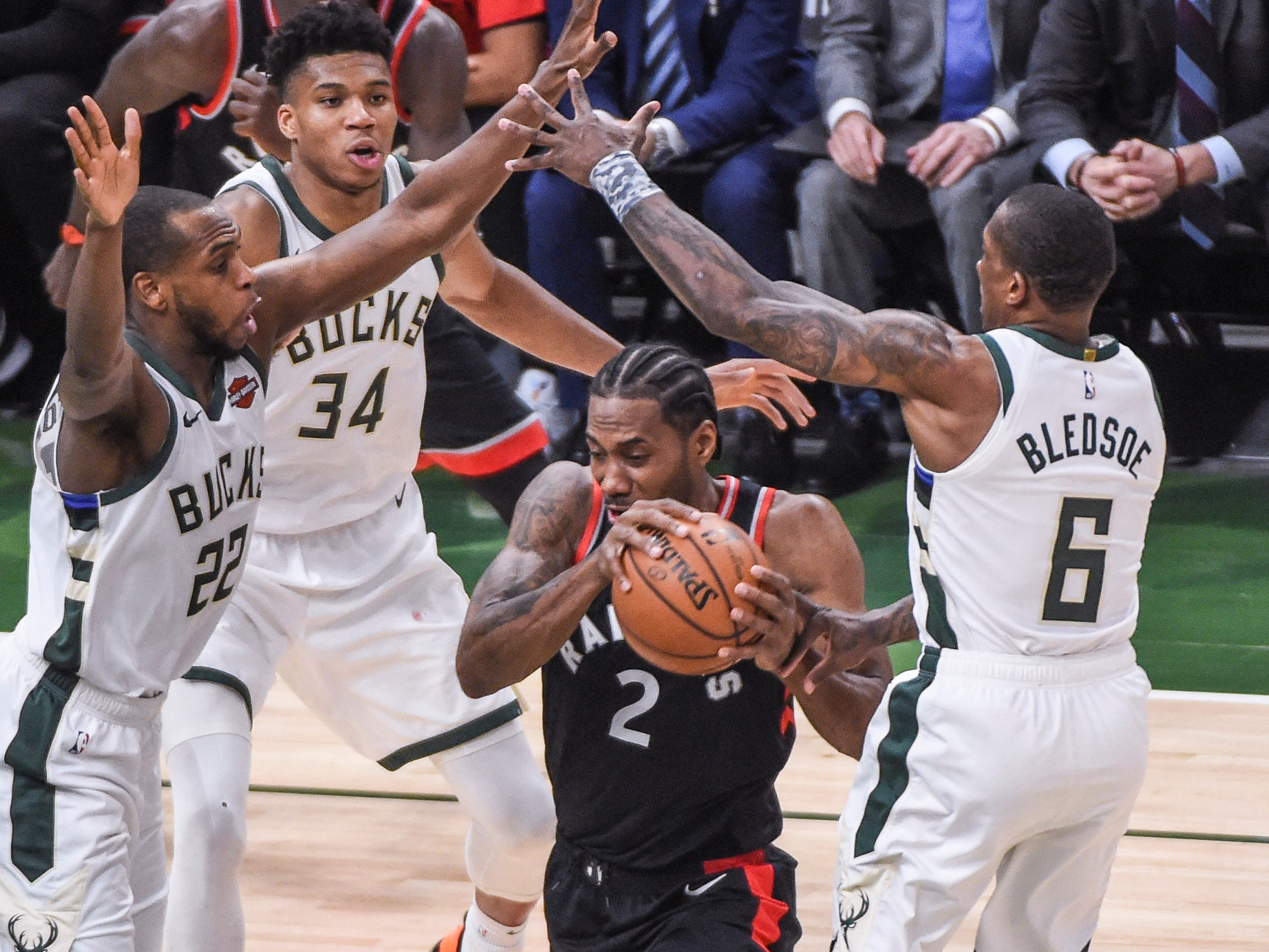 May 15: Raptors forward Kawhi Leonard (2) tries to find a way out of pressure from a trio of bucks defenders during Game 1.