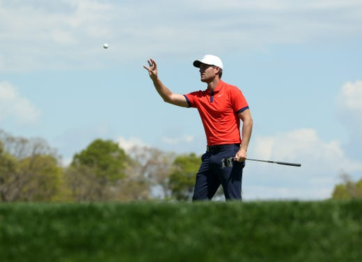 First round: Lucas Bjerregarrd catches a ball on the 11th green.