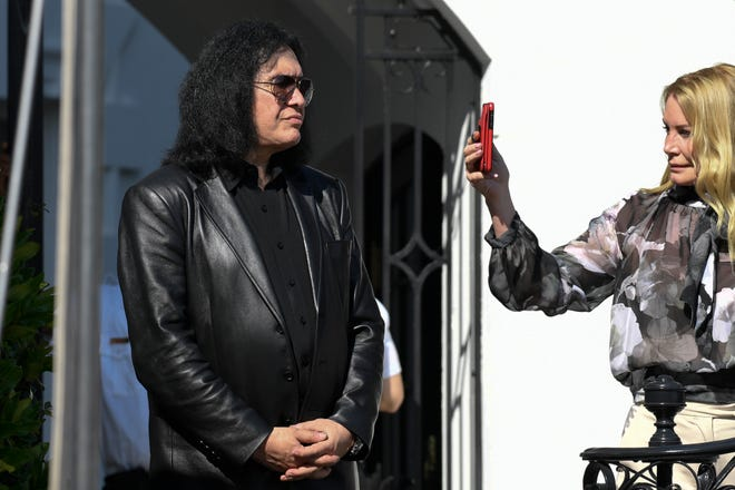 Gene Simmons and his wife Shannon Tweed watch the departure of President Donald Trump on Marine One on the South Lawn of the White House in Washington, Thursday, May 16, 2019. Trump is heading the New York for a campaign events.