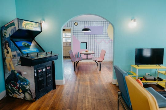 The McFly rental in Dallas will help you relive the '80s with colorful decor and retro games.