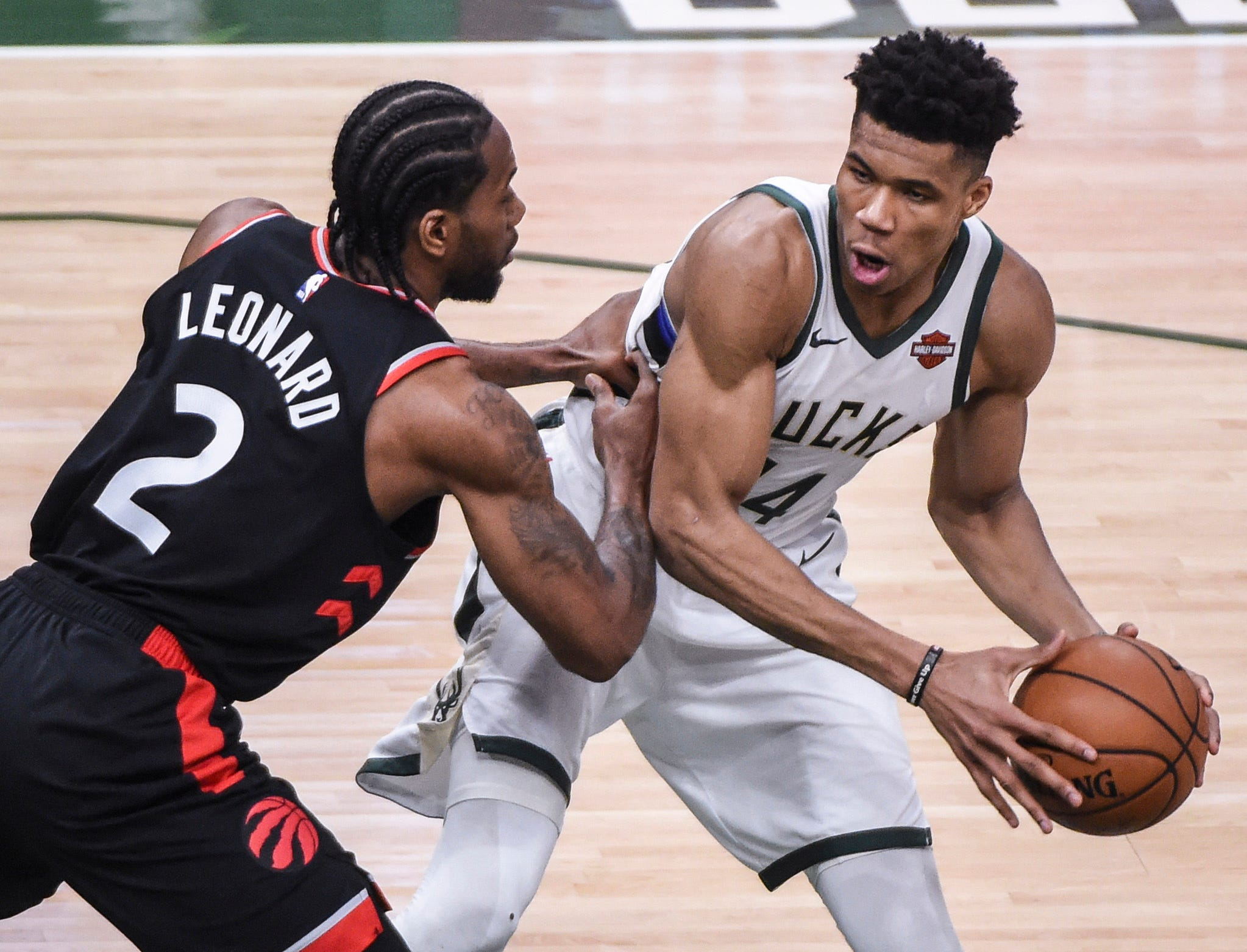 May 15: Bucks forward Giannis Antetokounmpo (34) looks for room to work against Raptors defender Kawhi Leonard (2) during Game 1 of the Eastern Conference finals in Milwaukee.