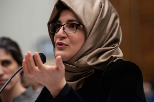 "Hatice Cengiz, the fiancee of slain Saudi journalist Jamal Khashoggi, gestures as she testifies before a House Foreign Relations subcommittee hearing on ""The dangers of reporting on human rights"" on Capitol Hill in Washington, DC, on May 16, 2019. (Photo by NICHOLAS KAMM / AFP)NICHOLAS KAMM/AFP/Getty Images"
