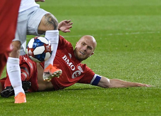 May 15: Toronto FC midfielder Michael Bradley battles for the ball against DC United in the second half at BMO Field.