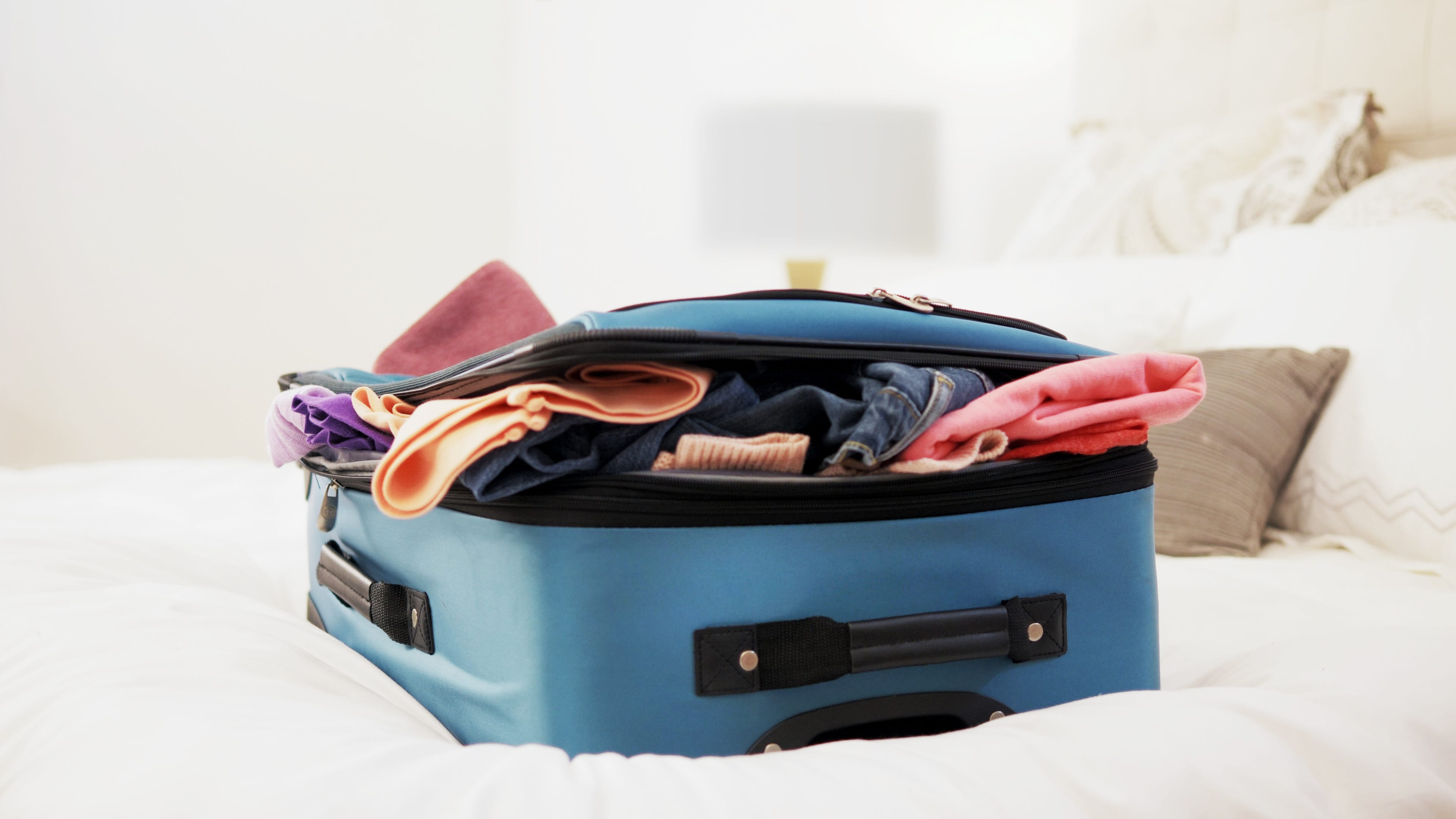 If you don't have the budget for travel clothes, you can make smarter shopping decisions. Avoid cotton and denim, which don't travel well, and find a polyester or spandex blend that will withstand the rigors of the road.