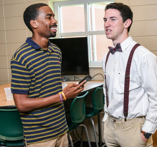 Sports writer Kennington Smith, left, interviews Gabe Golden (signed with Erskine College soccer) after a ceremony at Easley High School in Easley in April.