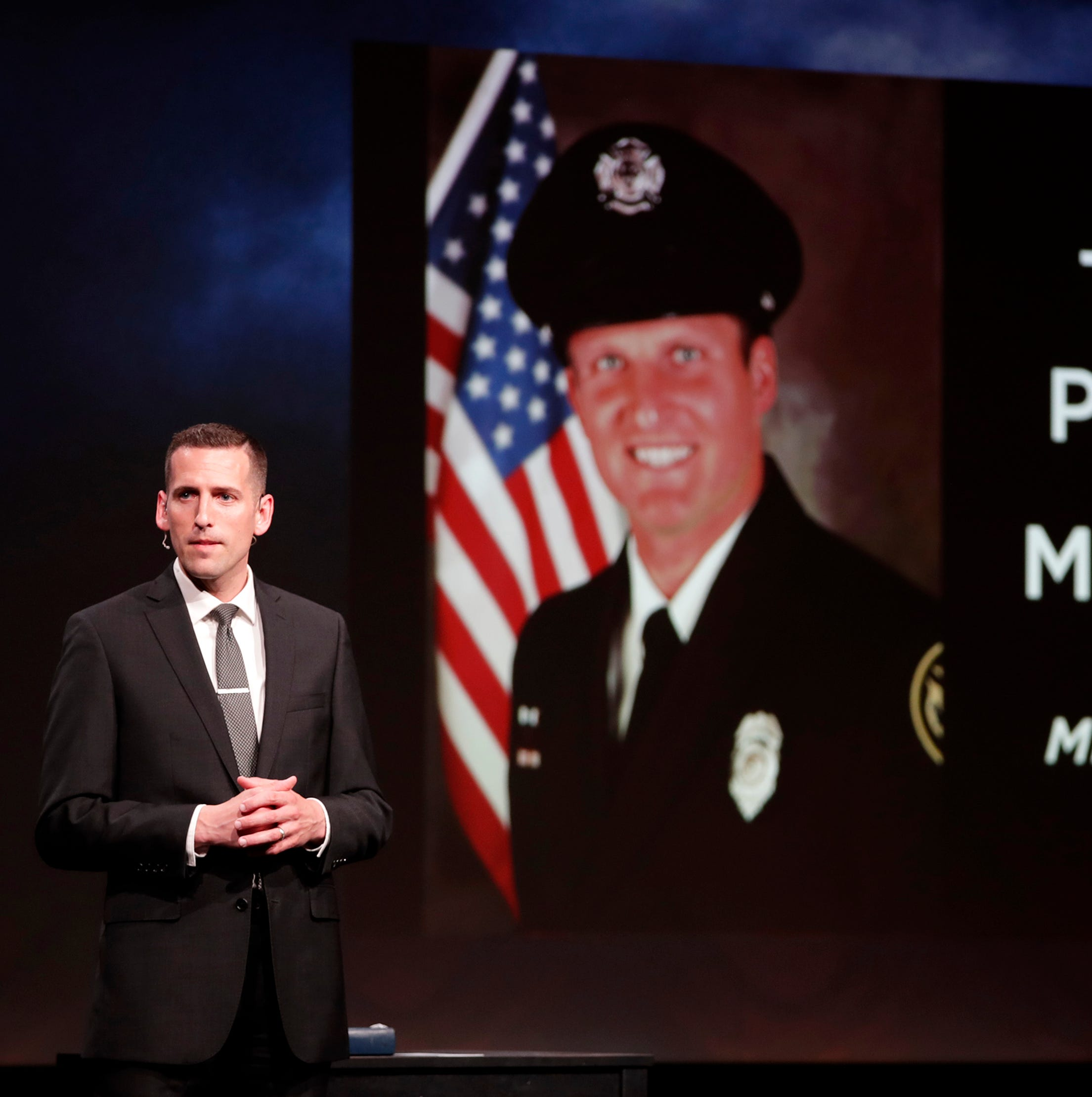 Community members honor Appleton firefighter Mitchell Lundgaard, who was killed in shooting, with vigil