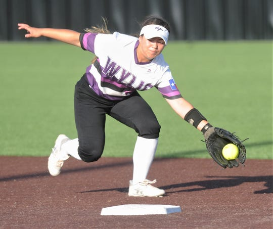Wylie shortstop Halle Arbilera stretches for Oliva Wick's ground ball in the second inning. It went as a two-run single, capping a four-run inning for The Colony. The Lady Cougars went on to beat Wylie 7-1 in the opener of the Region I-5A semifinal playoff series Thursday, May 16, 2019, at Graford.