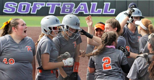 Rotan players celebrate a two-run home run by Ryleigh Denton, third from left, in the first inning Thursday against Borden County in Game 1 of their Region I-1A championship series at Poly Wells Field at Abilene Christian University. Rotan won, 9-8. May 16, 2019.