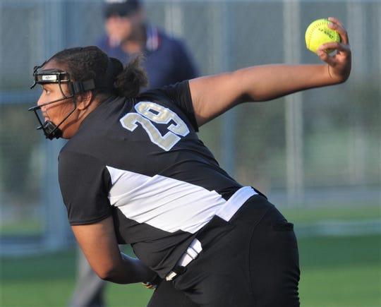 The Colony pitcher Karlie Charles gets ready to throw a pitch to a Wylie batter in the fourth inning. Charles scattered six hits, while drive in five runs in the Lady Cougars' 7-1 victory over Wylie in the Region I-5A semifinal series opener Thursday, May 16, 2019, at Graford.