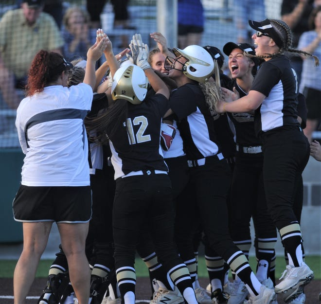 The Colony players congratulate Karlie Charles at home plate after Charles' two-run home run in the fifth inning gave the Lady Cougars a 7-0 lead. The Colony beat Wylie 7-1 in the opener of the Region I-5A semifinal playoff series Thursday, May 16, 2019, at Graford.