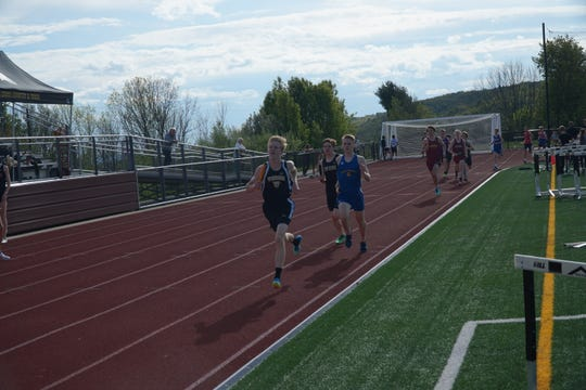 Josh Stone of Windsor gets the Black Knights off to a fast start in the 3,200-meter relay in Thursday's STAC Championships at Johnson City. Windsor won the event.