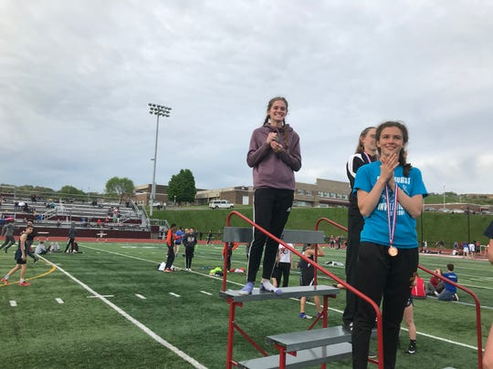 Lindsey Butler of Corning reacts to learning she'd set a Section 4 400-meter hurdles record at the STAC Championships.