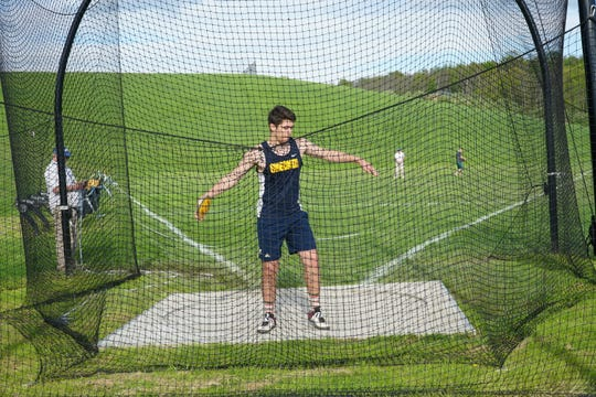 Oneonta High junior Brad Morell prepares to throw the discus Thursday during the STAC Championships at Johnson City. Morell won with a throw of 161 feet, 8 inches.