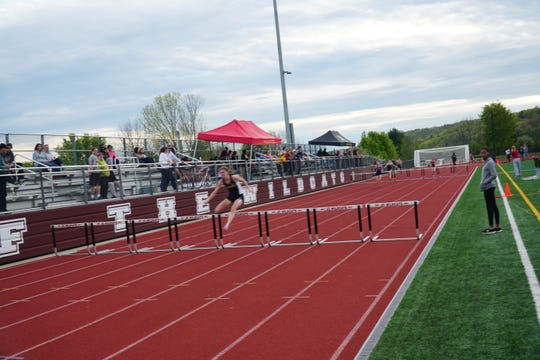 Corning's Lindsey Butler opens a sizable lead en route to winning the 400-meter hurdles during Thursday's STAC Championships. Butler won in a Section 4-record time.