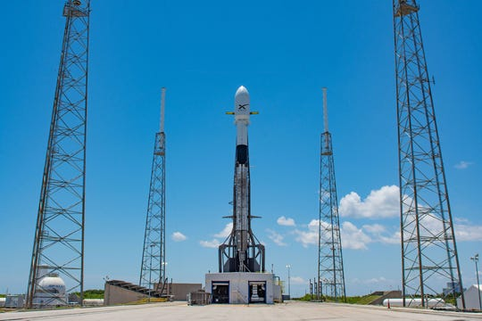 SpaceX's Falcon 9 rocket stands on the pad at Cape Canaveral Air Force Station's Launch Complex 40 on Thursday. Packed into its fairing are 60 Starlink satellites.