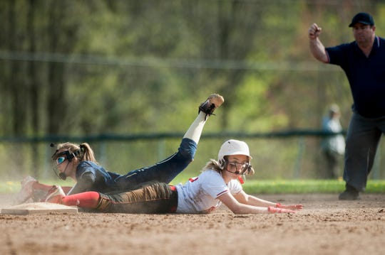 CVU's Taylor Detch (17) reacts after she is tagged out at second by Essex's Anna Sabourin (14) during the girls softball game between the Essex Hornets and the Champlain Valley Union Redhawks at CVU High School on Thursday afternoon May 16, 2019 in Hinesburg, Vermont.