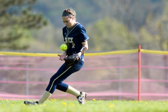 Essex's Erin Mulcahy (2) babbles the ball during the girls softball game between the Essex Hornets and the Champlain Valley Union Redhawks at CVU High School on Thursday afternoon May 16, 2019 in Hinesburg, Vermont.