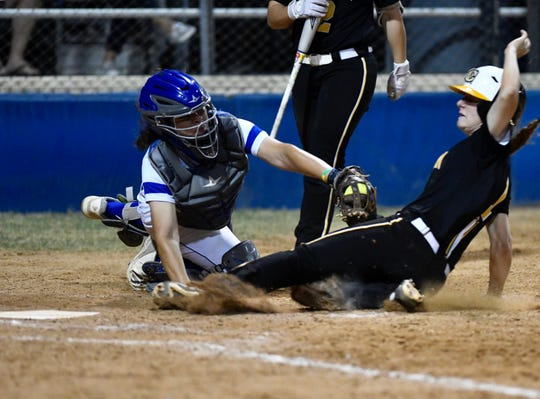Texas A&M-Kingsville catcher Roxy Chapa tags out a Cameron runner during Game 1 of their NCAA Division II softball tournament Super Regional series at Hubert Field in Kingsville on Thursday, May 16, 2019..