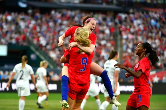 USA midfielder Rose Lavelle (16) celebrates with midfielder Lindsey Horan (9) and defender Cyrstal Dunn (19) after scoring against New Zealand goalkeeper Erin Nayler (not pictured) in the first half during a Countdown to the Cup Women's Soccer match at Busch Stadium.