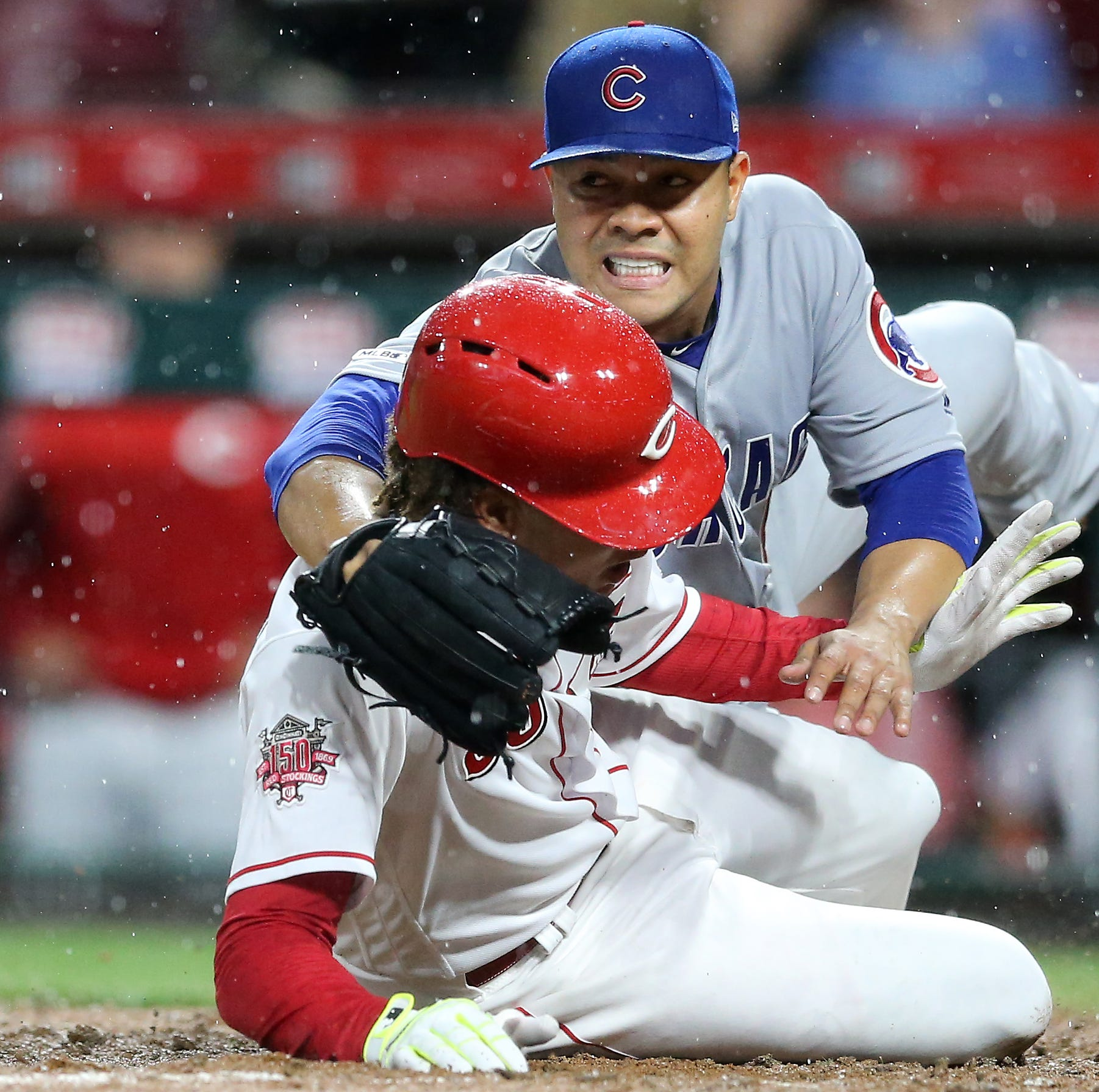 Cincinnati Reds rally against Chicago Cubs before rain delay, win 2 of 3 games in series