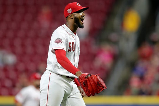 Cincinnati Reds relief pitcher Amir Garrett (50) reacts after striking out the side in the seventh inning during an MLB baseball game against the Chicago Cubs, Thursday, May 16, 2019, at Great American Ball Park in Cincinnati. Cincinnati won 4-2.