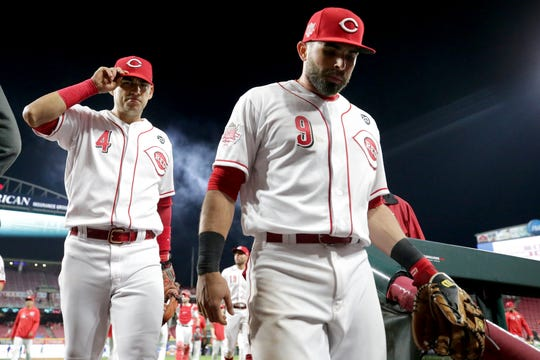 Cincinnati Reds shortstop Jose Iglesias (4) and Cincinnati Reds second baseman Jose Peraza (9) walk off the field after the win in the ninth inning during an MLB baseball game against the Chicago Cubs, Thursday, May 16, 2019, at Great American Ball Park in Cincinnati. Cincinnati won 4-2.