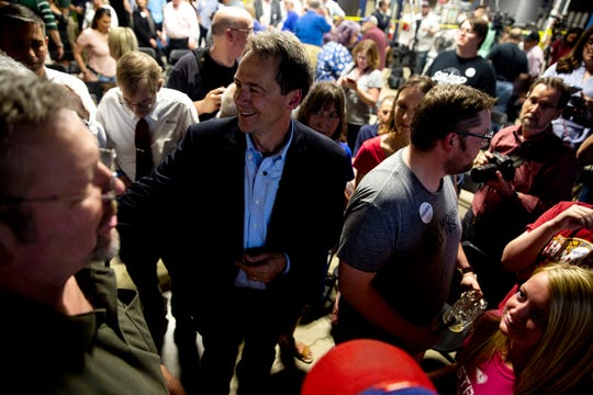 Steve Bullock, Governor of Montana, talks with people in the crowd after speaking at Confluence Brewing Company on Thursday, May 16, 2019, in Des Moines. This is Bullock's first visit to Iowa after announcing his 2020 bid.
