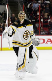 Boston Bruins goalie Tuukka Rask reacts as time expires against the Carolina Hurricanes following Game 4.