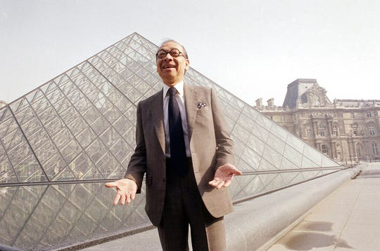 In this March 29, 1989, file photo, Chinese-American architect I.M. Pei laughs while posing for a portrait in front of the Louvre glass pyramid, which he designed, in the museum's Napoleon Courtyard, prior to its inauguration in Paris. Pei, the globe-trotting architect who captured the spirit of rebellion at the multi-shaped Rock and Roll Hall of Fame, has died at age 102, a spokesman confirmed Thursday, May 16, 2019.