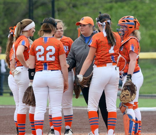 Thomas A. Edison head coach Liz Warren talks to her players during a 2-1 win over Waverly in the Interscholastic Athletic Conference softball championship game May 16, 2019 at Cornell's Niemand-Robison Field.