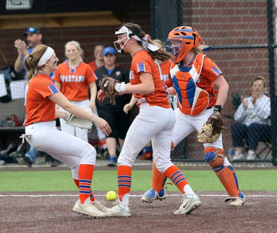 Thomas A. Edison players KK Bush (left), Bella Willsey (center) and Christina Willsey (right) celebrate their 2-1 win over Waverly in the Interscholastic Athletic Conference softball championship game May 16, 2019 at Cornell's Niemand-Robison Field.