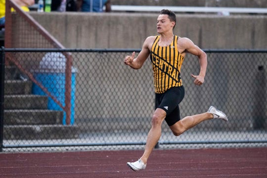 Central's Jalen Bowman runs in the 200 meter dash event of the Boys 2019 IHSAA Track and Field Sectionals at Central Stadium in Evansville, Ind. Thursday, May 16, 2019.