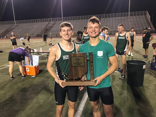North's Drew Hale and Dylan McKinney display the Central Sectional first-place team trophy.