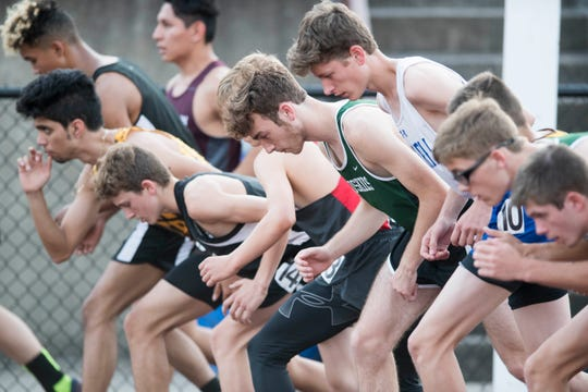 Runners ready for the 1600 meter run during the Boys 2019 IHSAA Track and Field Sectionals at Central Stadium in Evansville, Ind. Thursday, May 16, 2019.