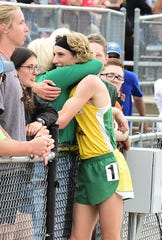 Heritage Christian Academy's Seth Bruxvoort hugs a family member after setting a Colorado Class 1A state-meet record in the boys 3,200 meters of 9 minutes, 47.15 seconds on Thursday, May 16, 2019, at Jeffco Stadium in Lakewood.